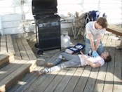 CPR performed on girl outside on deck.JPG