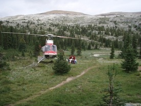 helicopter landing in high mountain pass